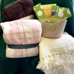 Stuck in the snow in the car… Three warm throws, four travel cups, 1 book (Peony in Love). Approx $110