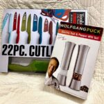 Wolfgang Puck electric salt and pepper mills, Tools of the trade 22 piece cutlery set. Approximately $100